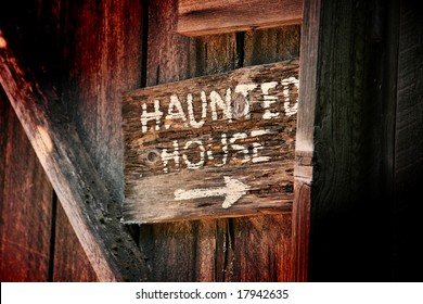 Haunted House Sign on Old Wooden Building