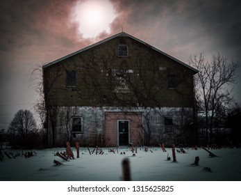 Haunting and vivid photo of an abandoned building behind a corn field.