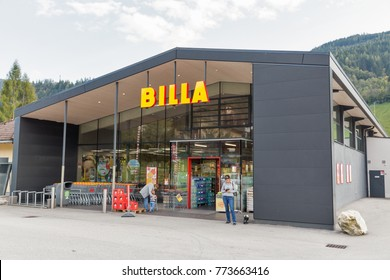 HAUS, AUSTRIA - SEPTEMBER 24, 2017: People visit Billa supermarket. Haus village is a small winter resort located in Styria, Austria.