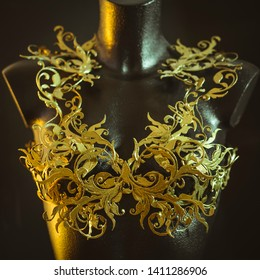 Haute couture, mannequin with piece of corset made with details of gold flourishes in Baroque or Renaissance style. Printed piece with 3d printer and ABS filament