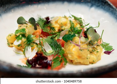 Haute cuisine appetizer with salmon and potatoes, close-up