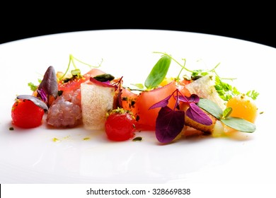 Haute cuisine appetizer with tuna tartare, watermelon and spices