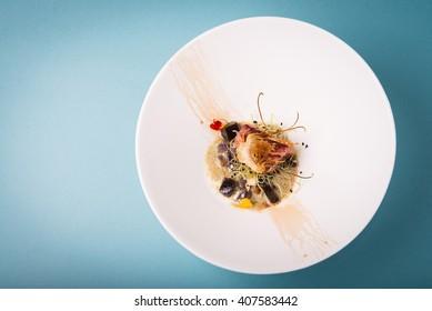 Haute cuisine presentation of tuna with crispy artichoke.