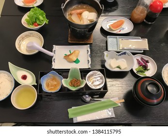 Haute multi course breakfast of  Japanese cuisine such as eggs, boiled sausage,vegetables, tea and fruit t. Better known as kaiseki
