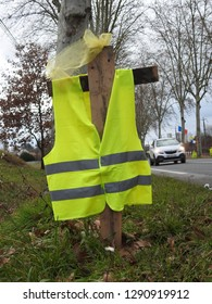 Haute-Garonne, France - January 21, 2019: Yellow vests movement (gilets jaunes) jacket displayed on the side of a road as sign of defiance against rising fuel prices, cost of living and tax reforms