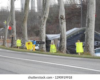 Haute-Garonne, France - January 21, 2019: Yellow vests movement (gilets jaunes) jackets displayed along a road in political statement about rising fuel prices, high cost of living and tax reforms