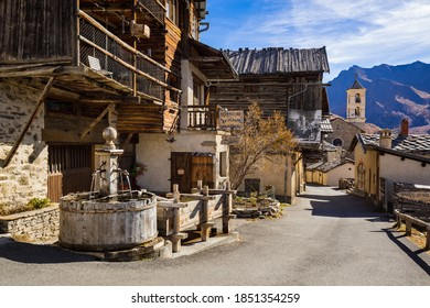 Saint-Véran, Hautes-Alpes, France - November 11, 2017: Saint-Veran and its wooden houses, fountain and church. One of the three highest villages in Europe. Queyras Regional Natural Park, French Alps