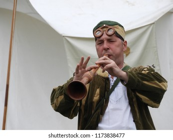Crécy-en-Ponthieu, Hauts-de-France, France-August 28, 2018: a minstrel plays a a medieval recorder-type instrument at the anniversary celebrations of the battle of Crécy in 1346  :