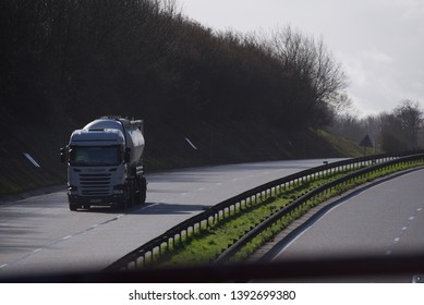 Hauts-de-France/France-5 March 2019: an LPG delivery truck heading north on the A26 autoroute, or motorway, south of Calais as seen from a road bridge crossing over it