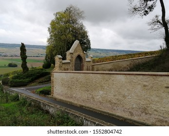 hautvillers, france - october 19 2019 : wall arounf the famous sloping vineyards of Dom Perignon in champaign.