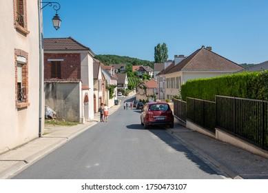 Hautvillers, Marne / France - July 24, 2016: View along Rue de Bacchus in Hautvillers in Champagne, France on a beautiful summer day.