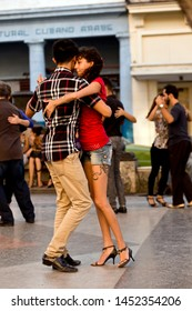 HAVAMA / CUBA - 03.16.2015: Young couples dancing salsa on street of Paseo de Marti, La Habana Vieja, Havana