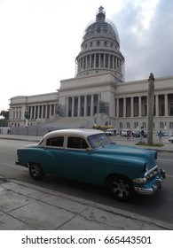 Havana 02.02.2017: Tourists enjoying a ride in a classic car on the streets of Havana,Cuba outside the Capitol building