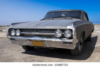 HAVANA - APRIL 27 2007: Classic American car parked at Old town Havana, Cuba on April 27 2007.