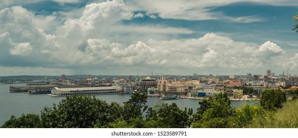 Havana, CAP / Cuba - September 3 2019: Panoramic view of Havana capital of Cuba with blue sky sea and beautiful buildings.