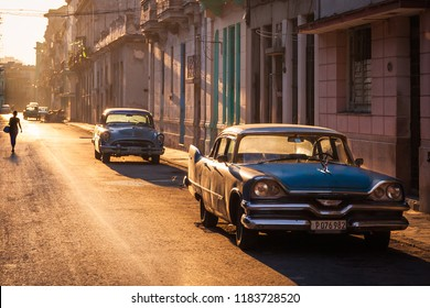 HAVANA - CIRCA AUGUST 2015: Vintage cars and colonial buildings in Centro Havana, Havana, Cuba