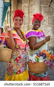 HAVANA - CIRCA AUGUST 2015: Women in traditional Cuban dress, Old Havana, Cuba
