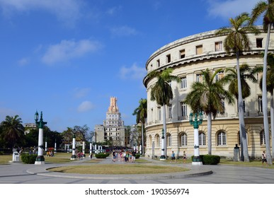 HAVANA - CIRCA MARCH 2012: Tourists and local people walk in the gardens near the Captolio. The Capitolio was the Cuban seat of government until 1959 but now houses the Cuban Academy of Sciences.