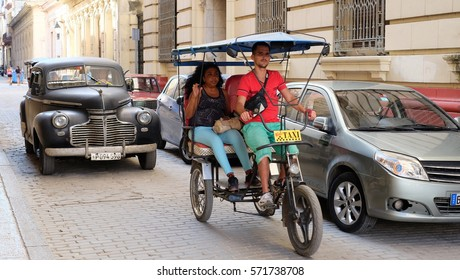 HAVANA CITY, CUBA - NOVEMBER 2016: Cuban people and classic cars on the streets of Old Havana area.