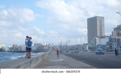 HAVANA CITY, CUBA - NOVEMBER 2016: Landscape of the Malecón (officially named Avenida de Maceo) - a broad esplanade, roadway and seawall which stretches for 8 km along the coast in Havana, Cuba.