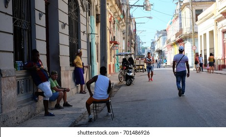 HAVANA CITY, CUBA - NOVEMBER, 2016: People and transportation on the street of old Havana.