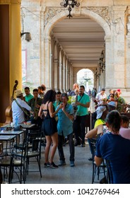 Havana, Cuba - 02 10 2018: Unidentified patrons having lunch and entertainment in Havana's numerous restaurant. Music is a major factor in the hospitality industry.