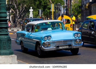 Havana, Cuba - 02 12 2018: Vintage classic American cars in restored condition - provide transport for tourism.
