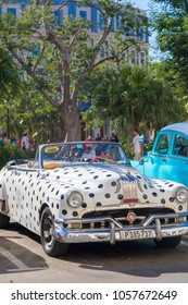 Havana, Cuba - 02 16 2018: Vintage classic American cars in restored condition - provide transport for tourism.