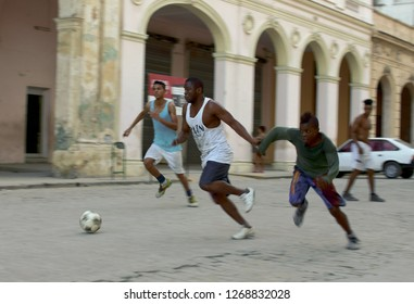 Havana, Cuba. 02/09/2014 Cuban teenagers play football or soccer in the courtyard in Old Havana. Amateur football in Cuba. Latinos slum football. Football players from the slums.