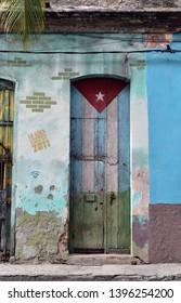 "HAVANA - CUBA / 03.05.2017: Old house in Havana Vieja painted with the Cuban flag and a ""Viva Cuba"" Libre writing"