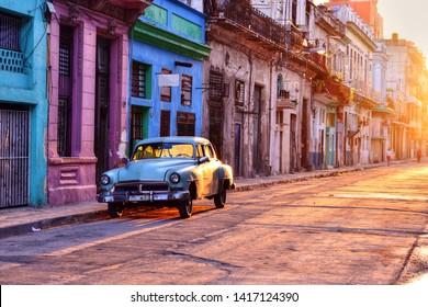 HAVANA - CUBA / 03.07.2017: Old blue american car parked on the street in Havana Vieja, Cuba