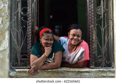 HAVANA - CUBA / 09.03.2017: Cuban ladies are looking out from a window in Havana Vieja