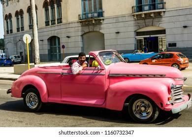 Havana, Cuba - 2018. Pink american classic car used as a taxi in Havana, capital of Cuba.