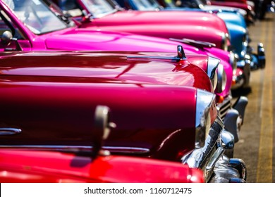 Havana, Cuba - 2018. Vintage american classic cars on the streets of Old Havana, Cuba. Close up photo of classic cars parked.
