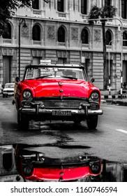Havana, Cuba - 2018. Vintage american classic car on the streets of Old Havana, Cuba. Rainy day in Havana.