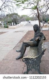 Havana, Cuba - 27 April 2018: Statue in John Lennon Park or Parque John Lennon (formerly known as Parque Menocal) located in Vedado district, Havana, Cuba sculpted by Cuban artist José Villa Soberón.