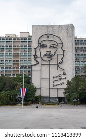 Havana, Cuba - 27 April 2018: Woman walks past Plaza de la Revolucion (Revolution Plaza) in front of the offices of the Ministries of the Interior and Communications and Che Guevara memorial.