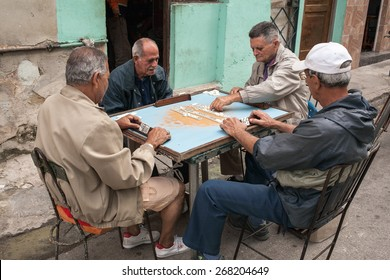 Havana, Cuba - 27 January, 2015 - Old men plays domino on a street in Centro Havana neighborhood.