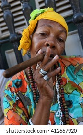 Havana, CUBA - 28 OCTOBER 2012: Portrait of african cuban woman smoking cigar in Havana, Cuba.