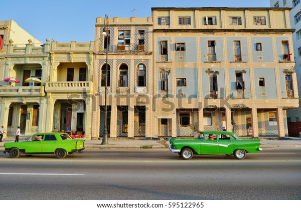 HAVANA, CUBA -3 FEB 2017- Vintage classic American cars driving on the Malecon, the famous coastal road in Havana, the capital of Cuba.