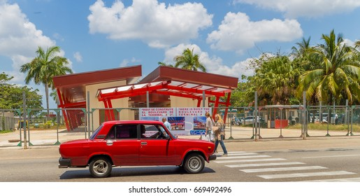 Havana, Cuba - 4/27/2017; Old American car picking up passengers at Havana airport