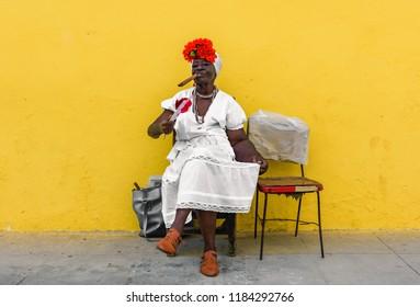 Havana, Cuba - April 12, 2017: Cuban Lady with a cigarr