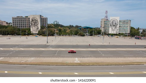 Havana, Cuba - April 13, 2017: Revolution square in Havana with featuring an iron mural of Camilo Cienfuegos' face in the Ministry of Communications and Che Guevara's face on Ministry of Interior