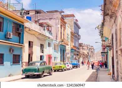 HAVANA, CUBA - APRIL 14, 2017: Authentic view of a street of Old Havana with old buildings and cars