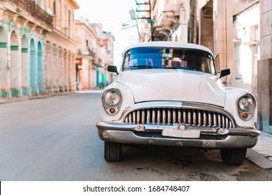HAVANA, CUBA - APRIL 14, 2017: Classic vintage car the most popular transport for tourist as taxi in old Havana at Cuba.