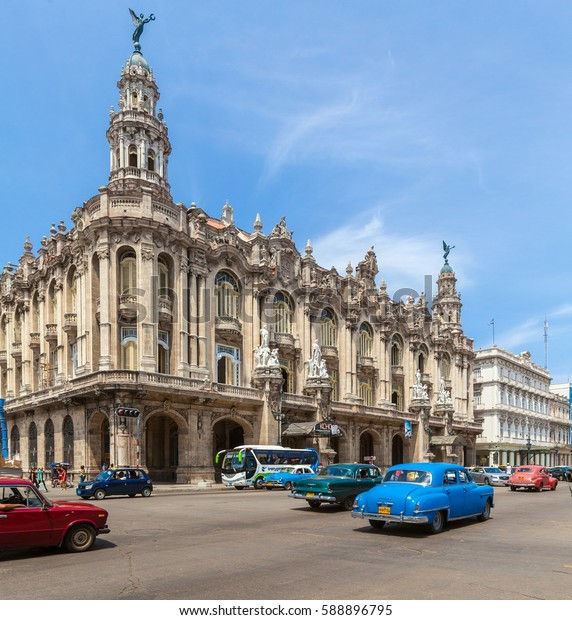 HAVANA, CUBA - APRIL 2, 2012: Many vintage cars on the road in front of Great Theater