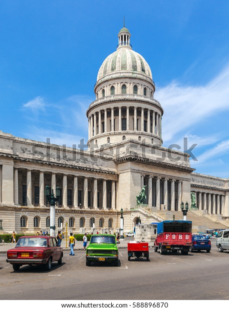 HAVANA, CUBA - APRIL 2, 2012: Heavy traffic with vintage cars in front of Capitolio