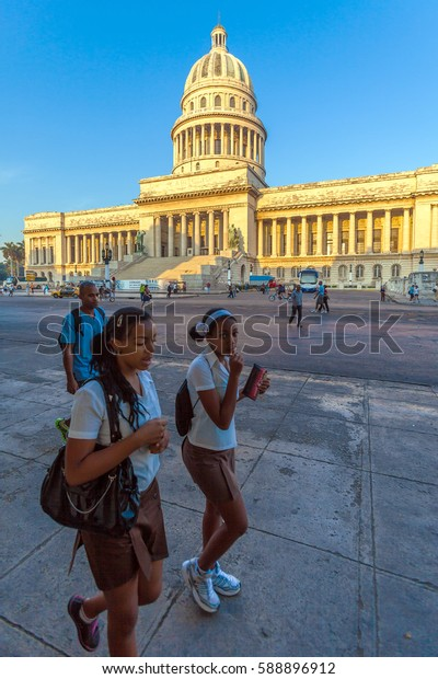 HAVANA, CUBA - APRIL 2, 2012: Group of uniformed cuban students in front of Capitolio building
