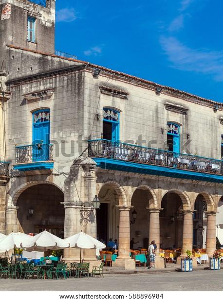 HAVANA, CUBA - APRIL 2, 2012: Tourist walking near El Patio Restaurant in the Cathedral Square