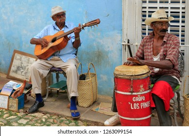Havana / Cuba - April 2015: Music and music albums in Havana and almost all cities, music groups on the streets. Tourists are happy and have fun with dancing.